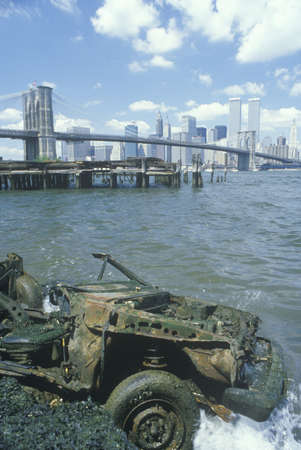 trashed: Junked car with Brooklyn Bridge beyond