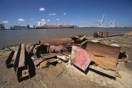 rusting: Rusting metal debris on shore