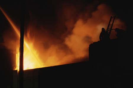 Raging fire against dark skies