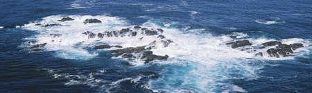 panoramics: Ocean waves crashing on rocks, California
