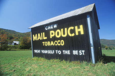advertise with us: A sign that reads �Chew Mail Pouch Tobacco - Treat Yourself to the Best� Editorial