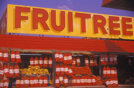 advertise with us: A sign that reads �fruitree� Editorial
