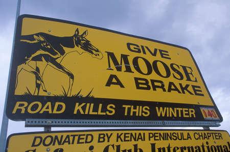 A sign that reads ÒGive moose a brakeÓ