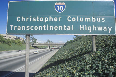 christopher: A sign that reads �Christopher Columbus Transcontinental Highway�