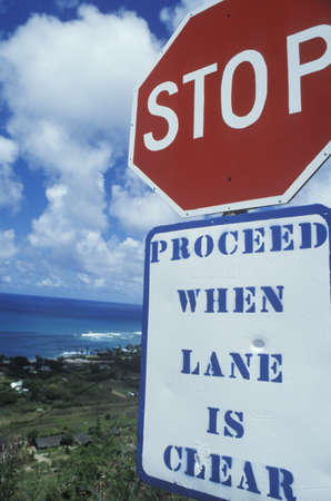 to proceed: A sign that reads �Stop - proceed when lane is clear�