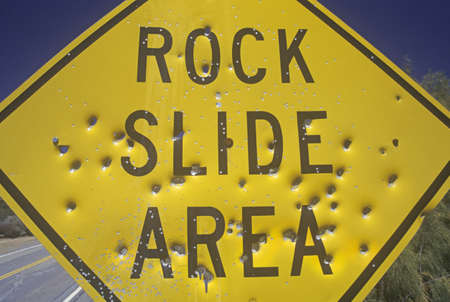 hole: Bullet holes in a ÒRock Slide AreaÓ sign, Southern California