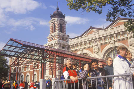 Tourists waiting in line to visit Ellis Island National Park, New York City, New York