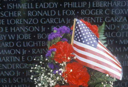 Flag and Flowers in front of Vietnam Wall Memorial, Washington, D.C.