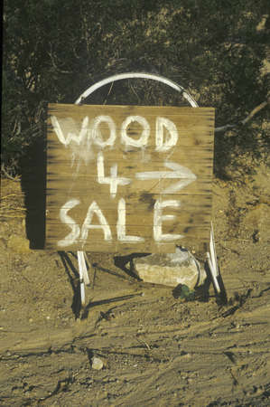 advertise with us: A sign that reads �Wood 4 sale�