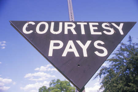 a courtesy: A sign that reads �Courtesy pays�