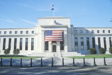 bank of america: American Flag hung on The Federal Reserve Bank, Washington, D.C. Editorial