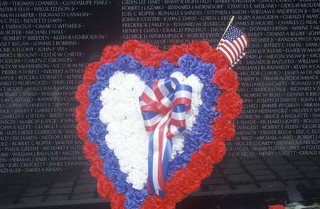 Wreath and Flag in front of Vietnam Wall Memorial, Washington, D.C.