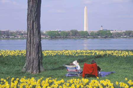 Couple reading in Lady Bird Park, the Potomac River, Washington, D.C.