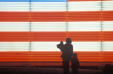 ut: Silhouetted family in front of an American electric Flag, Winter Olympics, Salt Lake City, Utah