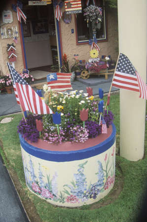 parade of homes: A yard planter decorated with American flags, Independence Day Parade, Cayucos, California