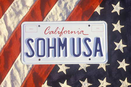 license plate: California License Plate �Sohm USA� Lying on American Flag, United States