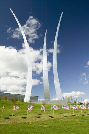 American flags at base of three soaring spires of the Air Force Memorial at One Air Force Memorial Drive, Arlington, Virginia in Washington D.C. area