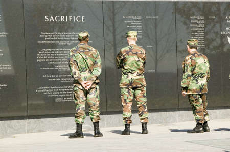 united states air force: Three servicemen look at granite inscription on wall of Air Force Memorial, Arlington, Virginia in Washington D.C. area Editorial