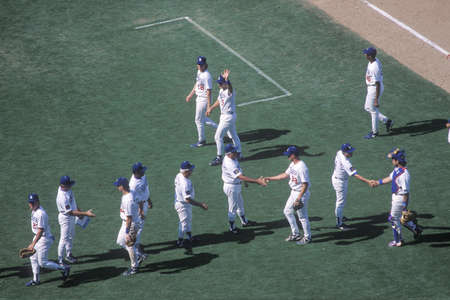 Overhead view of baseball players greeting each other on diamond, Dodger Stadium, Los Angeles, CA