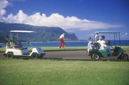 Golf Caddies and carts on course in Pacific Princeville, Kauai, HI