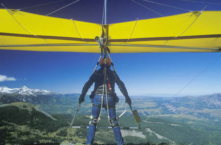 Rear view Close-up of Hang Glider taking off of cliff in mid air during Telluride Hang Gliding Festival, Colorado