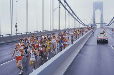 View of runners crossing Verrazano Bridge at the start of NY City Marathon