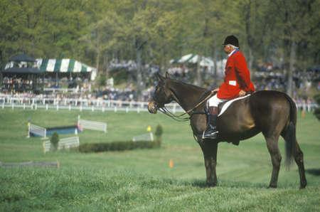steeplechase: Rider on horseback observing steeplechase field, Prind Steeplechase Glenwood Park, Middleburg, Virginia