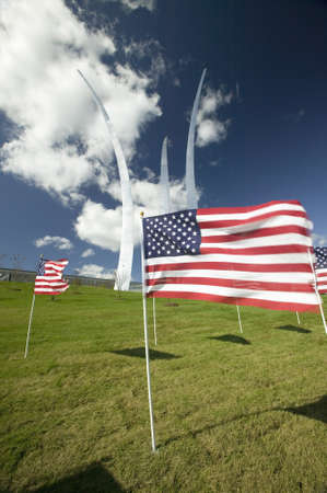 American flags at base of three soaring spires of the Air Force Memorial at One Air Force Memorial Drive, Arlington, Virginia in Washington D.C. area