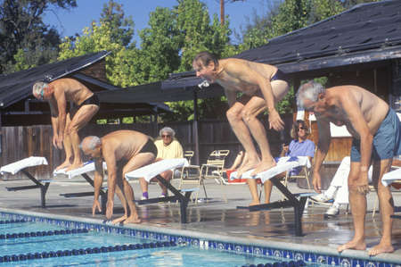 senior olympics: Senior Olympic Swimming competition, Men at starting gate, Ojai, CA
