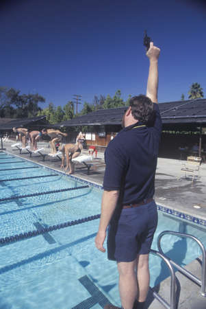 senior olympics: Senior Olympic Swimming competition, Man at starting gate, Ojai, CA