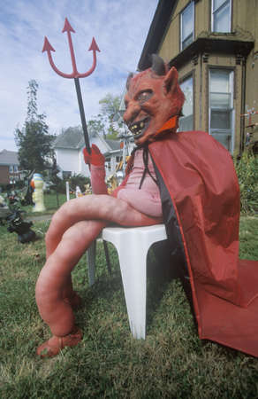 Dummy Dressed as the Devil for Halloween on Front Lawn, Illinois Stock Photo - 20491044