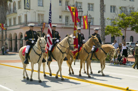 spaniards: Santa  Barbaras Old Spanish Days, Fiesta, August 3-7, 2005 US Marine Color guard on riding horses during opening day parade down State Street, Santa Barbara, California