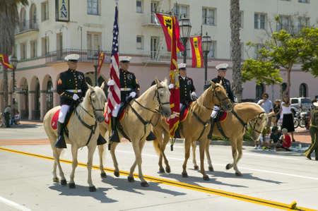 Santa  Barbaras Old Spanish Days, Fiesta, August 3-7, 2005 US Marine Color guard on riding horses during opening day parade down State Street, Santa Barbara, California