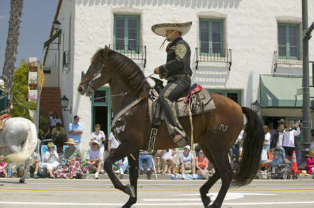 spaniards: Spanish cowboy on horseback during opening day parade down State Street, Santa Barbara, CA, Old Spanish Days Fiesta, August 3-7, 2007