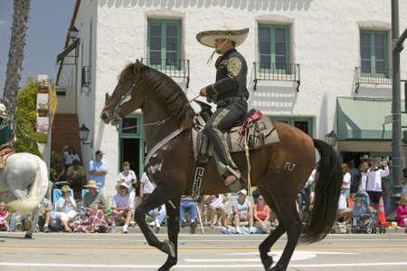 Spanish cowboy on horseback during opening day parade down State Street, Santa Barbara, CA, Old Spanish Days Fiesta, August 3-7, 2007