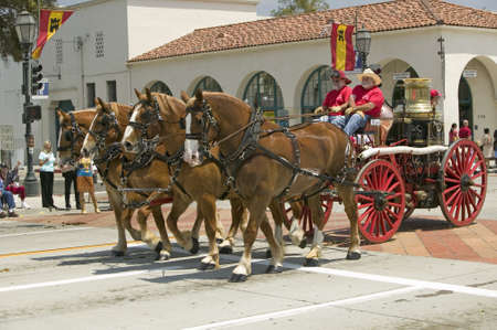 fiestas: Santa Barbara Fire Department pulling old fire engine during opening day parade down State Street, Santa Barbara, CA, Old Spanish Days Fiesta, August 3-7, 2005 Editorial