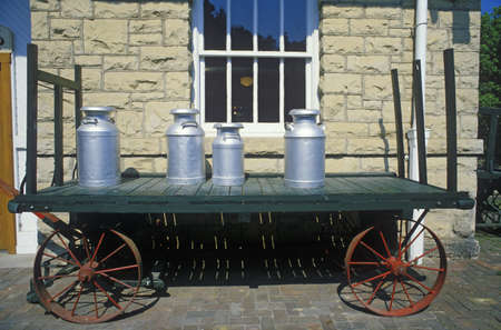 standard steel: An old standard gauge steam engine car holds antique milk cans in Eureka Springs, Arkansas Editorial