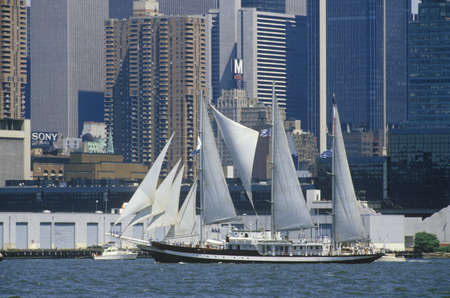 Tall ships sail in a parade in New York Harbor during the 100 year celebration for the Statue of Liberty, July 3, 1986