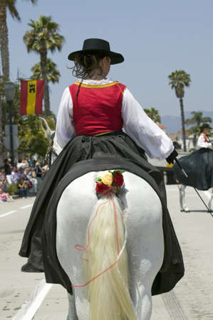 spaniards: Back of decorated horse riding in opening day parade down State Street, Santa Barbara, CA, Old Spanish Days Fiesta, August 3-7, 2006 Editorial