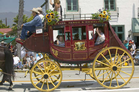 Stagecoach during opening day parade down State Street, Santa Barbara, CA, Old Spanish Days Fiesta, August 3-7, 2005 Stock Photo - 20474465