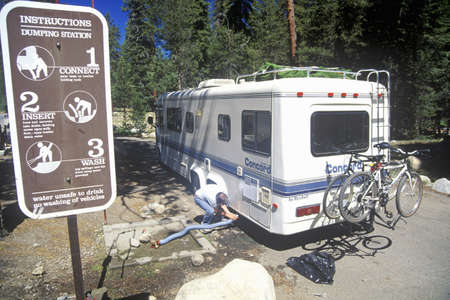 dumps: A recreation vehicle dumps its sewage in Sequoia National Park, California Editorial