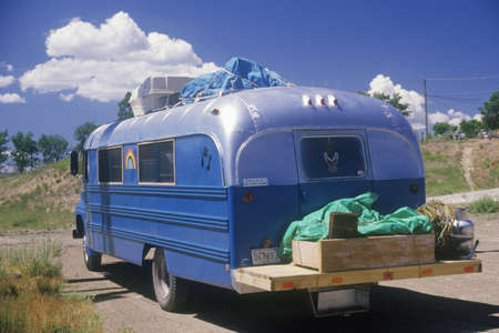 roughing: A homemade camper driving down the road to Taos, New Mexico Editorial