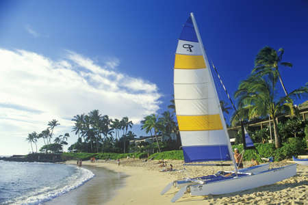 A sailboat launched on the beach in Kauai, Hawaii