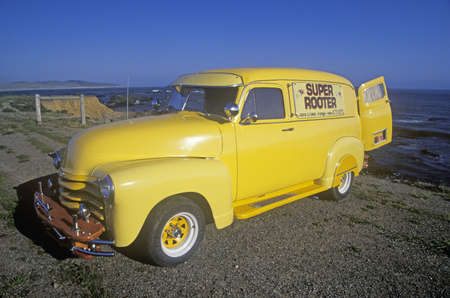 super highway: A yellow truck on the Pacific Coast Highway, California