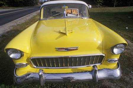 chevrolet: A yellow 1956 Chevrolet for sale in Maine Editorial