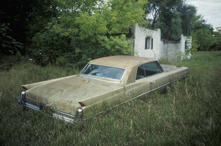 abandoned car: A classic car in a field in Wisconsin