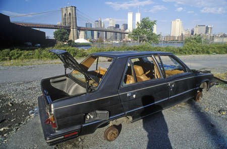 junked: An abandoned, stripped Volvo automobile near the Brooklyn Bridge in Brooklyn Editorial