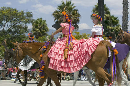 spaniards: Two girls with pretty Spanish dresses during opening day parade down State Street, Santa Barbara, CA, Old Spanish Days Fiesta, August 3-7, 2005 Editorial