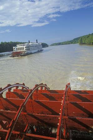 paddle wheel: A second steamboat paddles down the Mississippi ahead of the Delta Queens paddle wheel Editorial