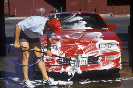 barstow: A man washing his red car in Barstow, California